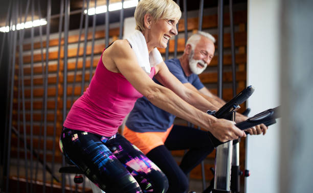 Vital mature couple exercising in the gym. stock photo