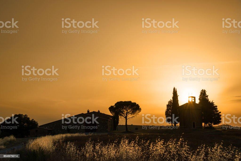 Vitaleta Chapel at sunset, Tuscan landscape near San Quirico d'Orcia, Siena, Tuscany, Italy stock photo