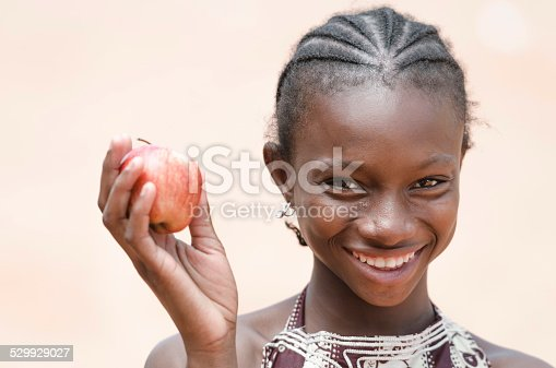 istock Vitality Healthy Eating Symbol: Smiling Young African Ethnicity Girl Apple 529929027