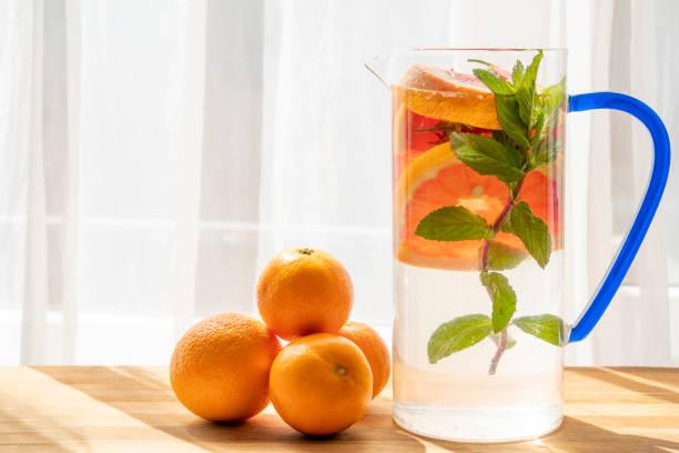 Vitamin and alkaline detox water under sunlight. stock photo