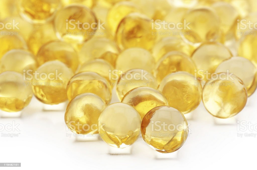 Vitamin and fish oil capsules royalty-free stock photo