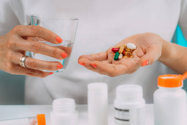 Vitamin and mineral supplements. Vitamin and mineral supplements. handful stock pictures, royalty-free photos & images