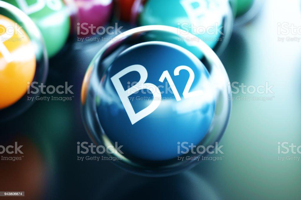 Vitamin B12, on black background. Symbol of health and longevity. 3d rendering stock photo