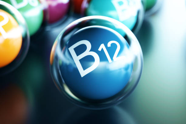 Vitamin B12, on black background. Symbol of health and longevity. 3d rendering stock photo