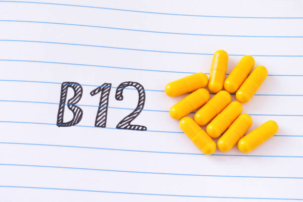 vitamin b12 on notebook sheet - deficient stock pictures, royalty-free photos & images