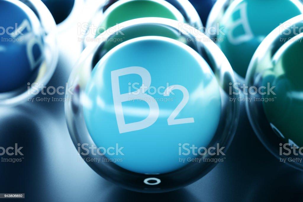 Vitamin B2, on black background. Symbol of health and longevity, 3d rendering stock photo