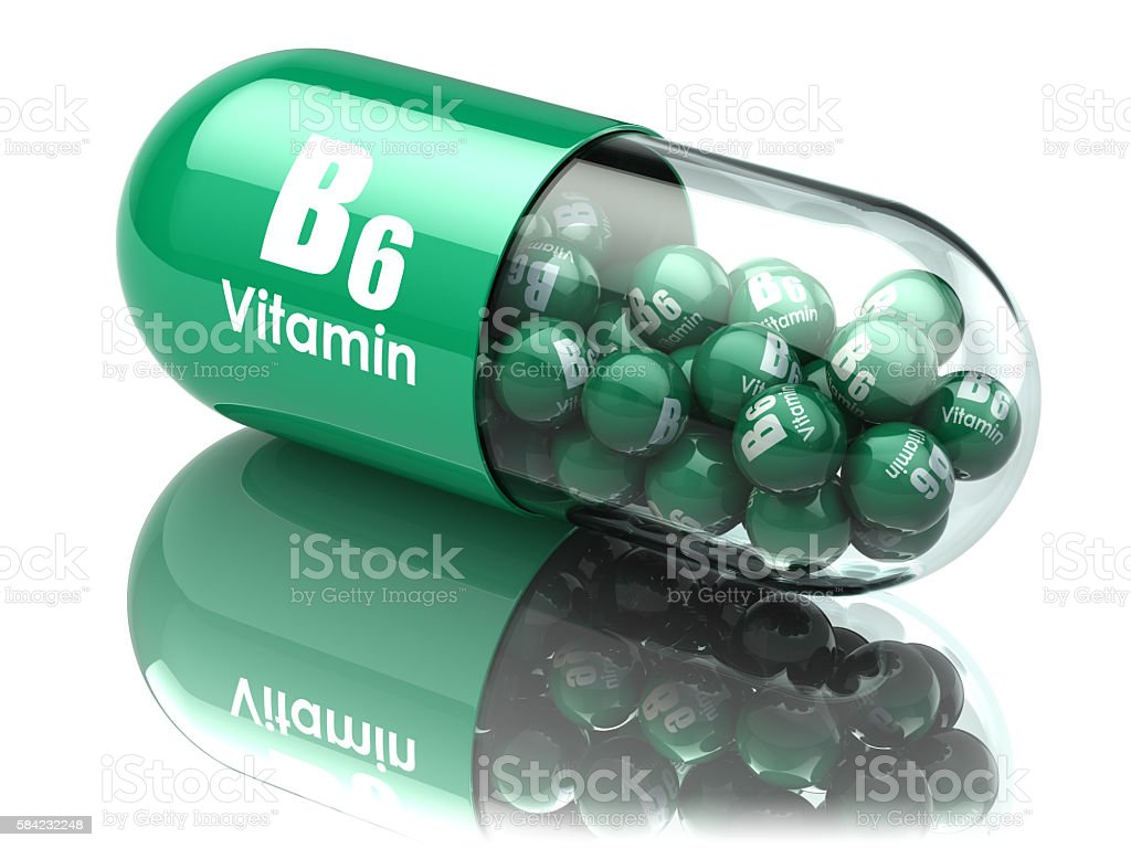 Vitamin B6 capsule or pill. Dietary supplements. stock photo