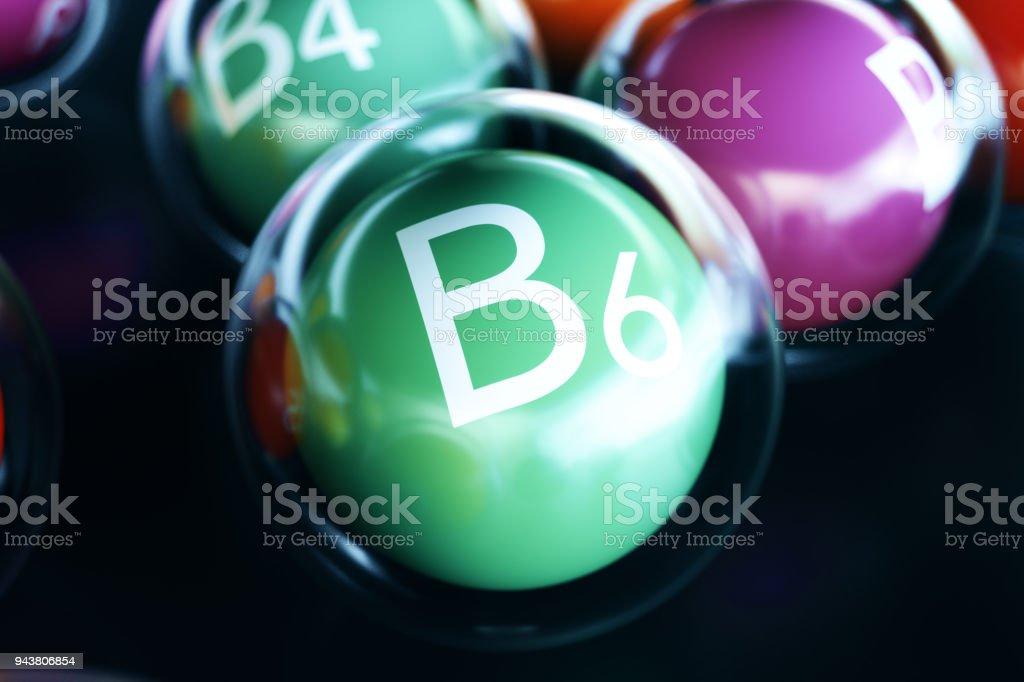 Vitamin B6 on black background. Symbol of health and longevity, 3d rendering stock photo