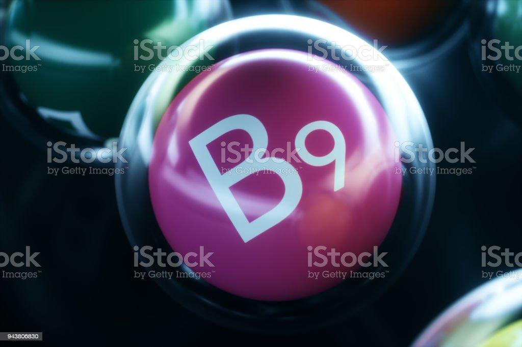 Vitamin B9, on black background. Symbol of health and longevity, 3d rendering stock photo