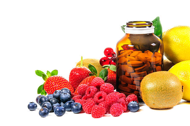 vitamin c and mix fruit - vitamin stock photos and pictures