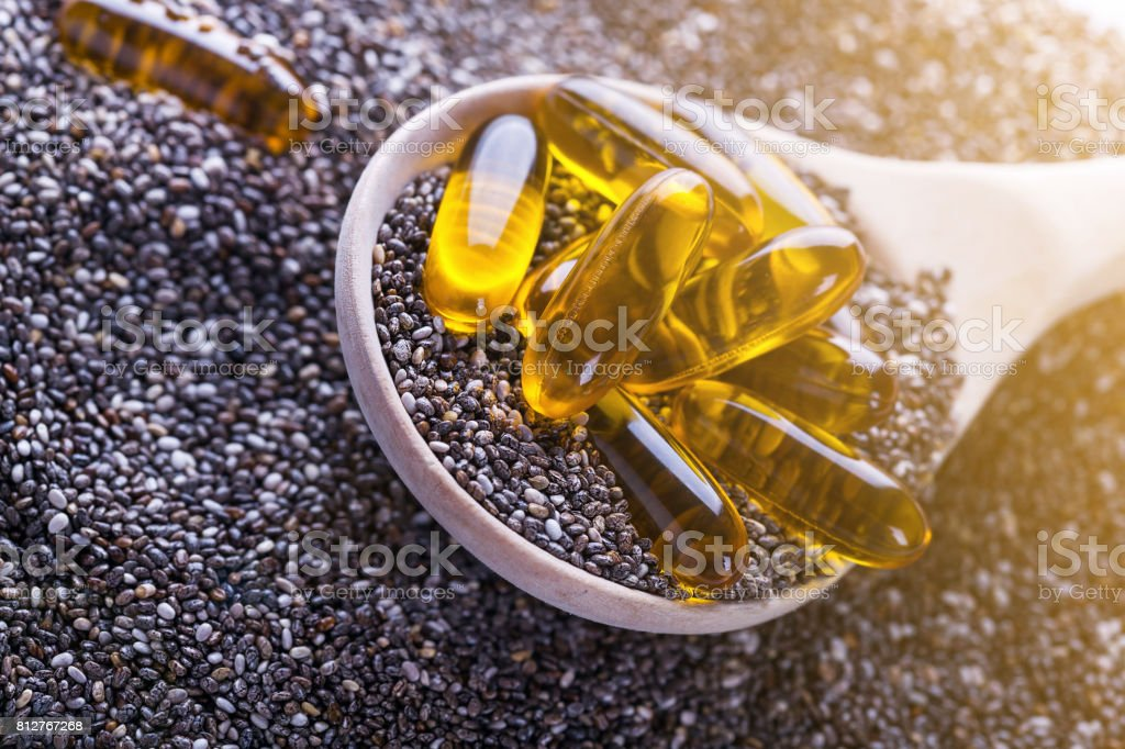 Vitamin capsules with chia oli, source of plants Omega-3 stock photo