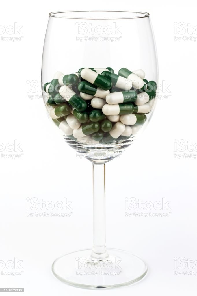 Vitamin cocktail. Pills in a glass. Treatment of diseases. Pharmaceutical industry. Healthy lifestyle. stock photo