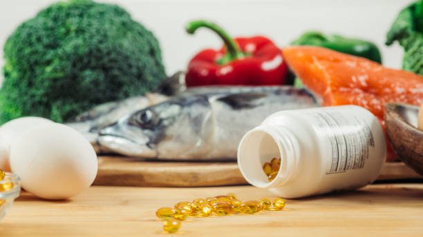 Vitamin D Gel Capsules and Natural Sources of Vitamin D stock photo
