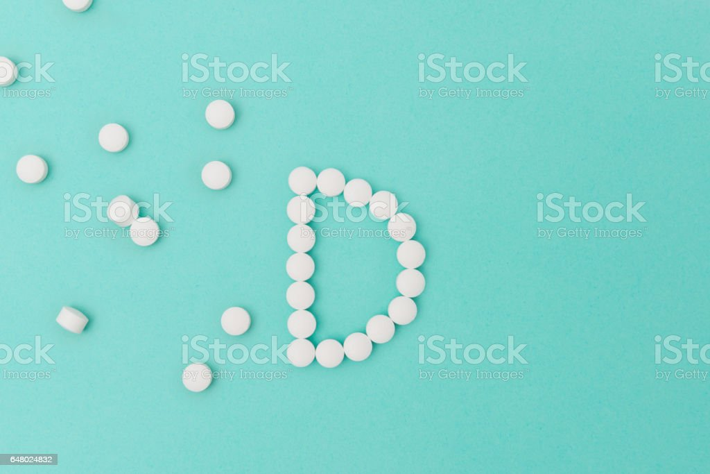 Vitamin D Pills Forming the Letter 'D' stock photo