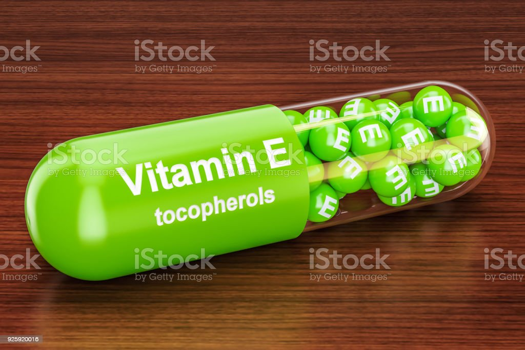 Vitamin E capsule on the wooden table. 3D rendering stock photo
