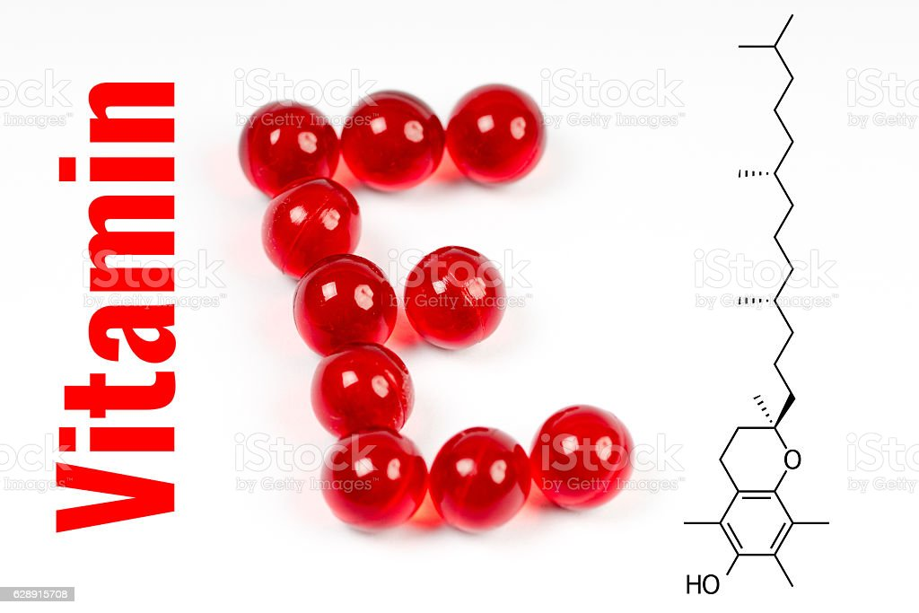 vitamin e, capsules with chemical structure stock photo