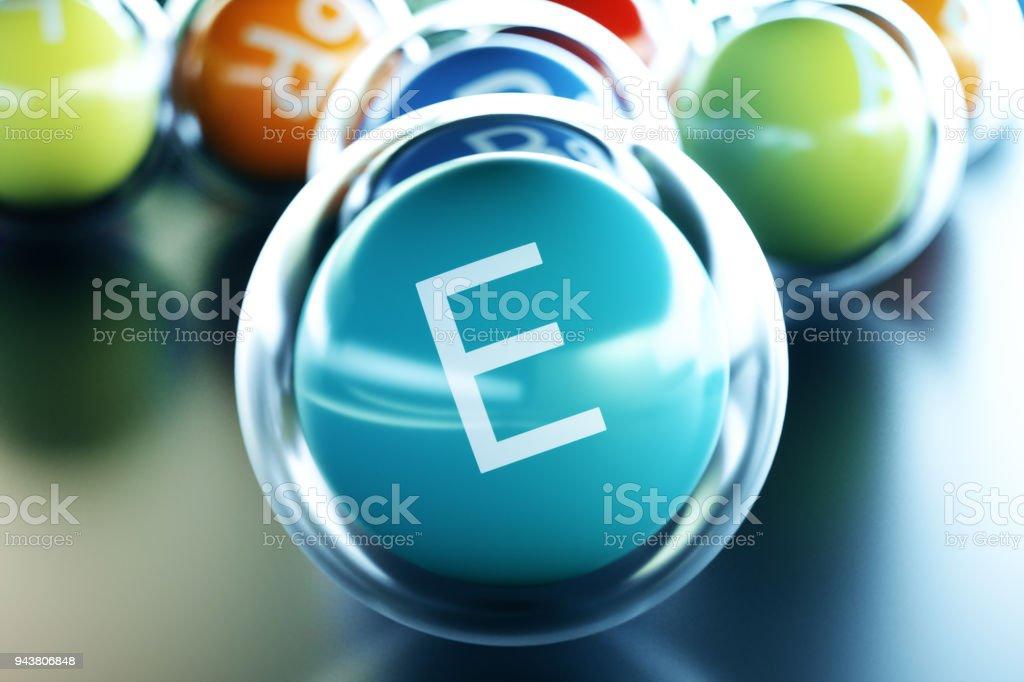 Vitamin E, on black background. Symbol of health and longevity, 3d rendering stock photo