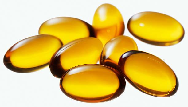 Vitamin e Tabletten-Schnitt auf Weiß – Foto