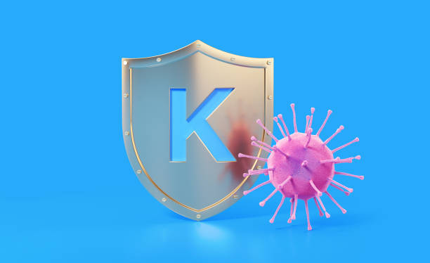 mavi arka planda hastalık kavramından k vitamini koruması - k logo stok fotoğraflar ve resimler