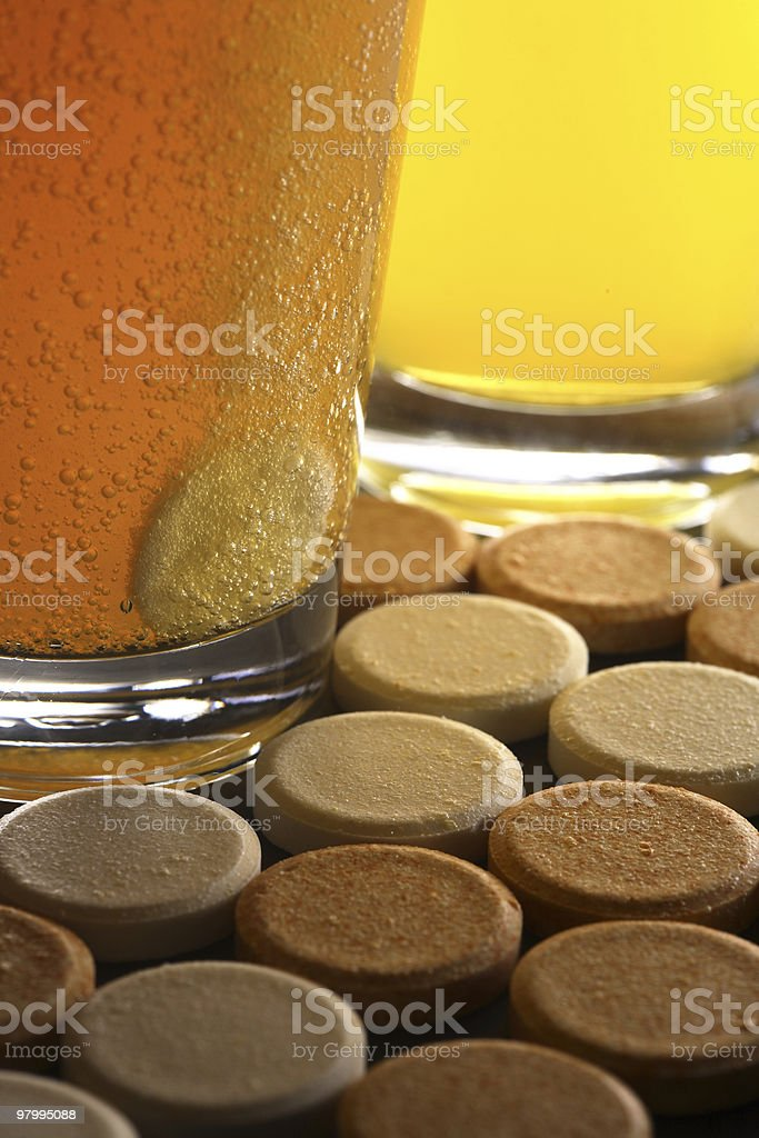 vitamin pill dissolving in purified water royalty-free stock photo