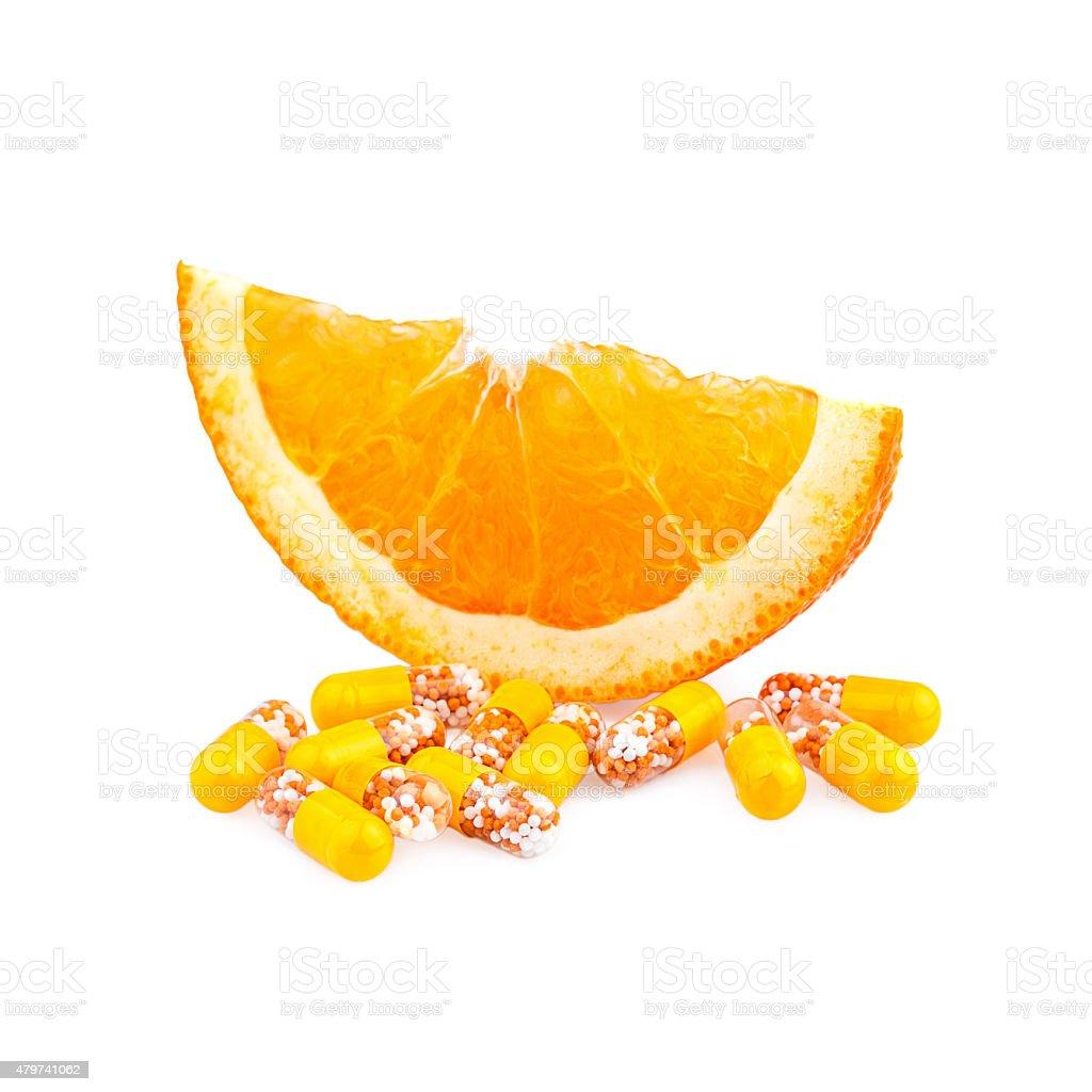 Vitamin pills and Orange Fruit stock photo