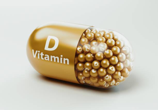 vitamin hapları veya kapsüller - vitamin d stok fotoğraflar ve resimler