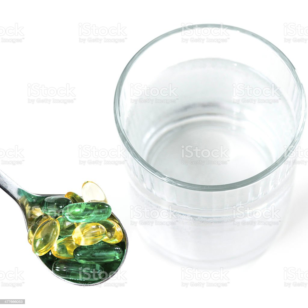 Vitamin pills with glass of water royalty-free stock photo