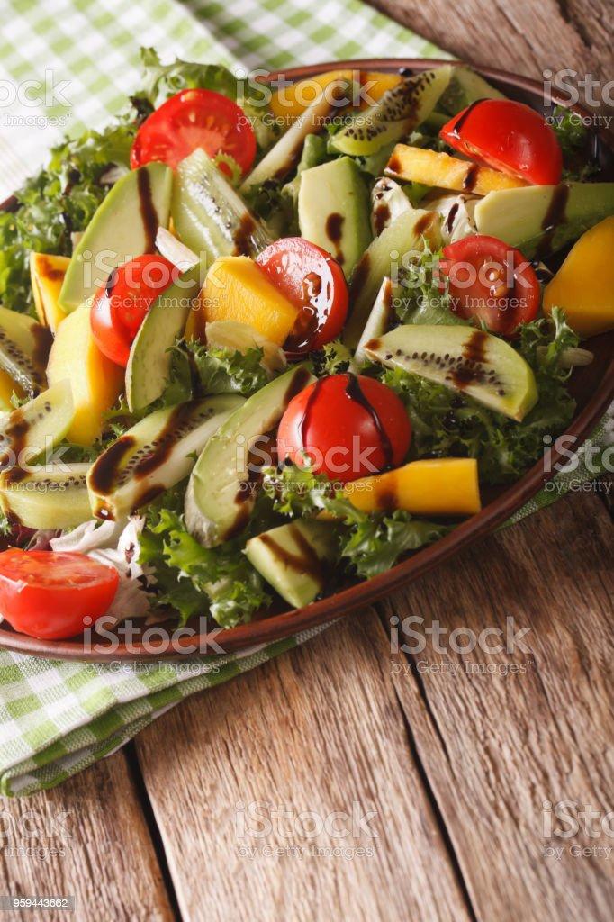 Vitamin Salad Of Mango Avocado Kiwi Tomato And Lettuce Closeup