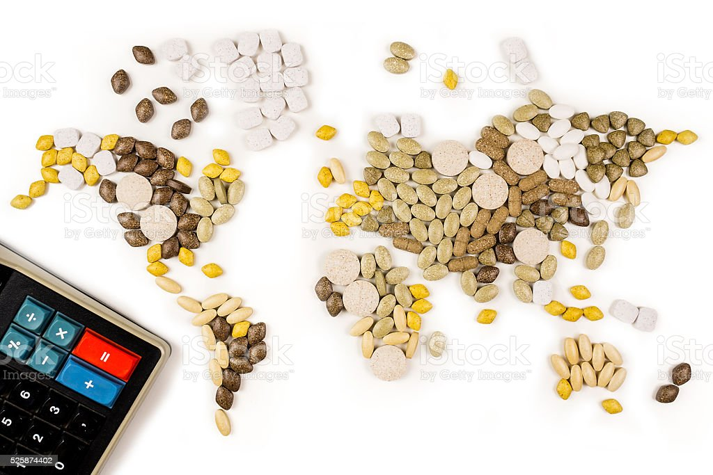 vitamin supplements forming map of the world stock photo