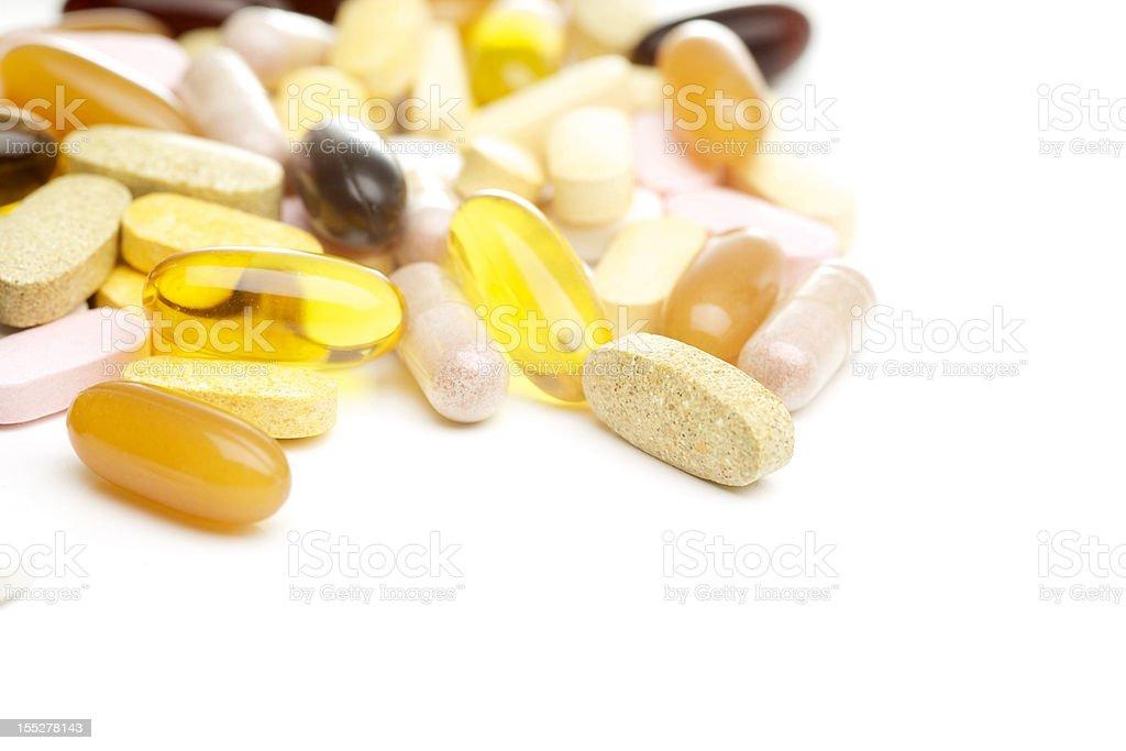 Vitamin supplements on white stock photo