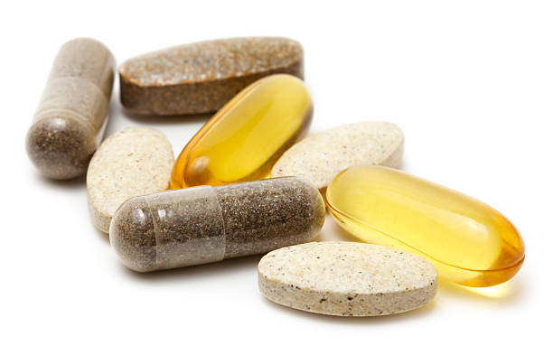 vitamin supplements - vitamin stock pictures, royalty-free photos & images