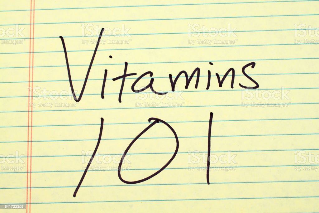Vitamins 101 On A Yellow Legal Pad stock photo
