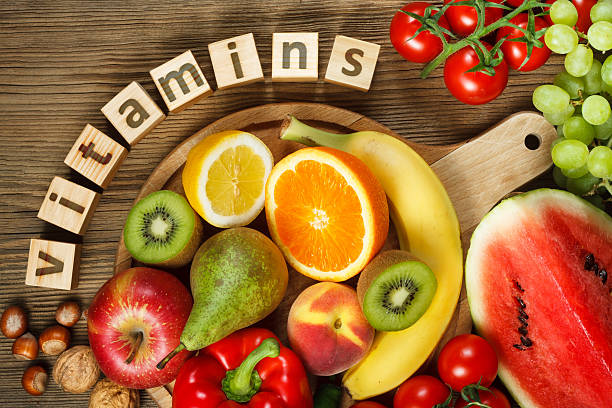 vitamins in fruits and vegetables - vitamina fotografías e imágenes de stock
