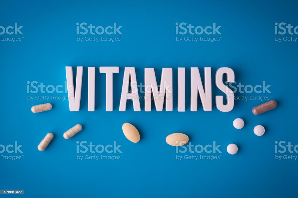 Vitamins lettering sign stock photo