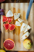 Close Up View of Fresh and Delicious Fruit on Wooden Cutting Board