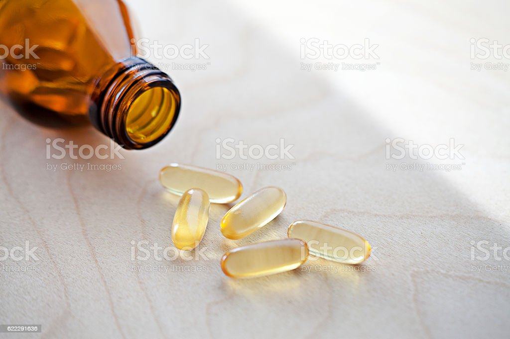 Vitamins with spilled content stock photo