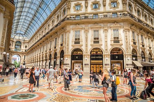 MILAN, ITALY, 19 JUNE 2017: Vittorio Emanuele gallery in Square Piazza Duomo at morning, Milan, Italy