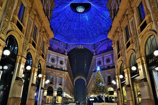 Vittorio Emanuele II Gallery brightly illuminated and Christmas tree.