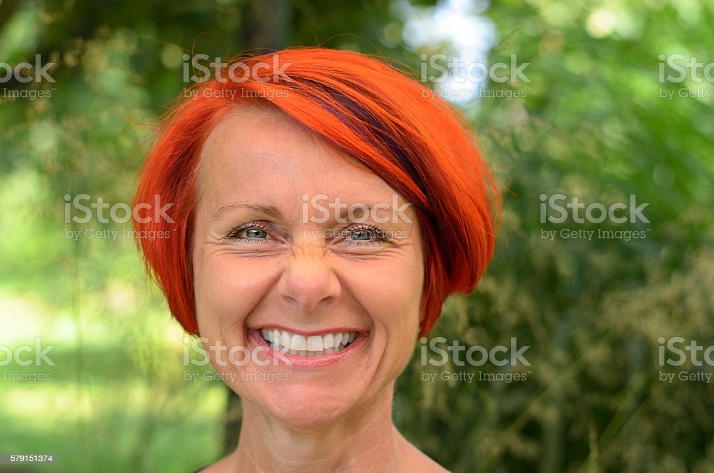 Vivacious middle-aged redhead woman stock photo