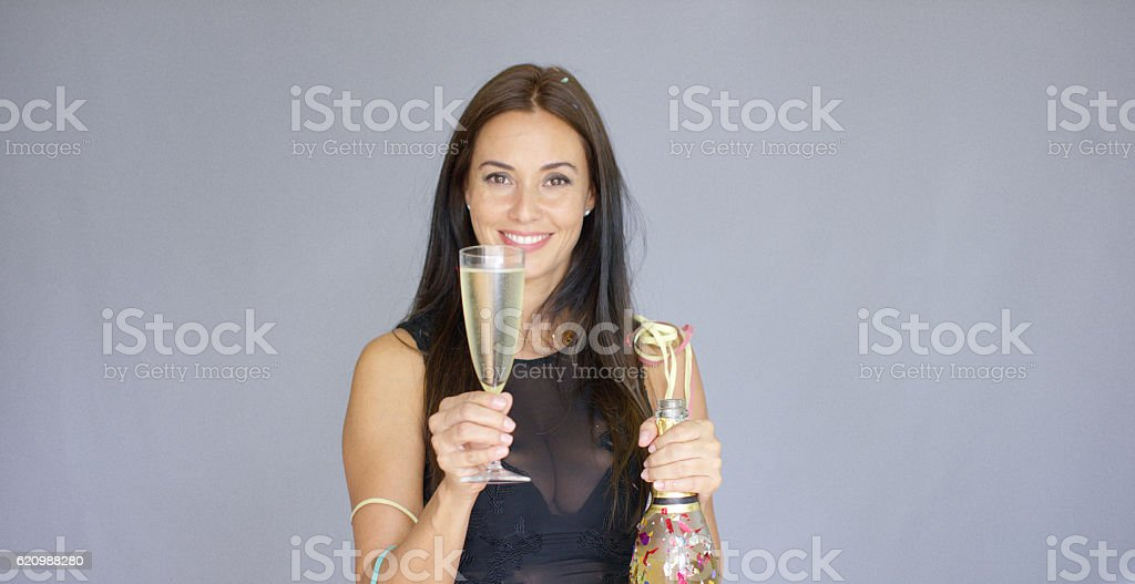 Vivacious woman partying at New Year foto royalty-free