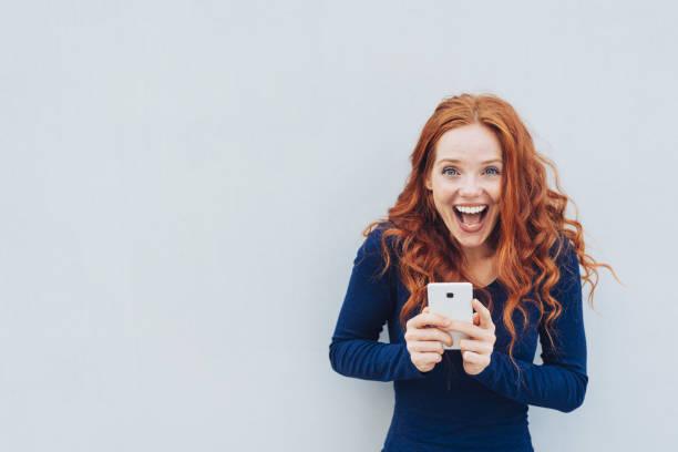 Vivacious young woman laughing at a good joke stock photo