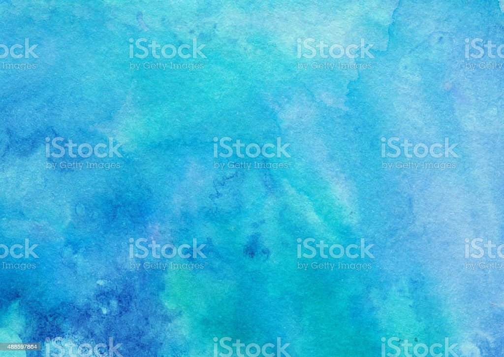 Vivid blue textured background hand painted on paper stock photo