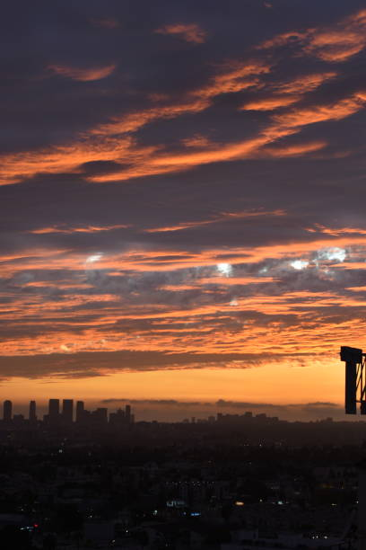 vivid cloudy sunset over west los angeles - steven harrie stock pictures, royalty-free photos & images