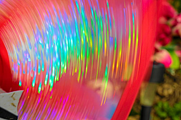 vivid colour whizzing whirring movement blur circular background - whiteway stock photos and pictures