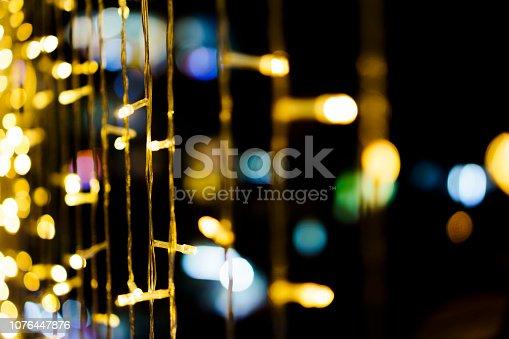 istock Vivid Defocused Multi Colored Lights 1076447876