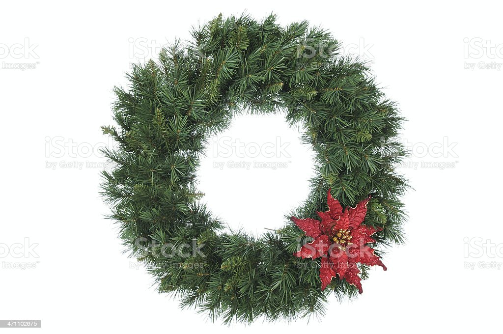 Vivid evergreen wreath, trimmed with a red bow  royalty-free stock photo