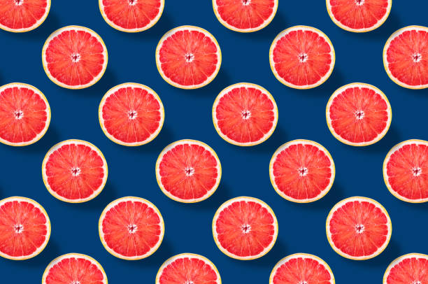 Vivid fruit pattern of fresh citrius on colourful background stock photo