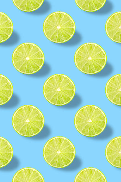 Vivid fruit pattern of fresh lime on colourful background stock photo