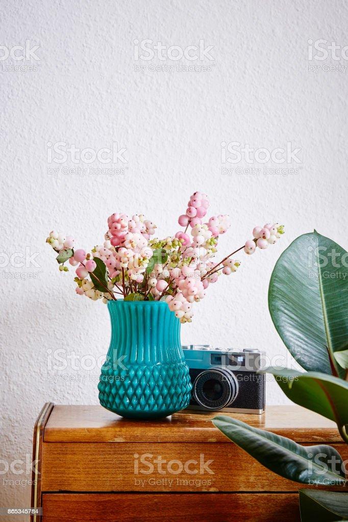 vivid interior design home style vase with snowberries stock photo