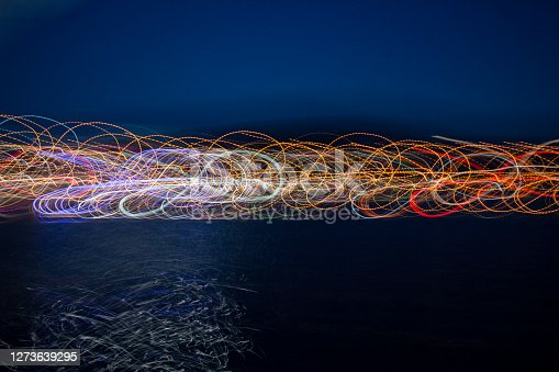 vivid light weave over the sea, abstract
